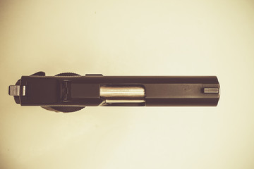 top view hand gun in retro style
