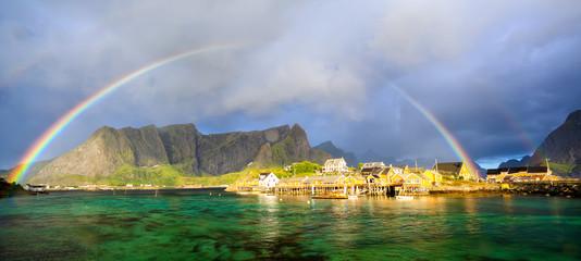 Fotomurales - Rainbow over Reine fishing village, Lofoten Islands, Norway