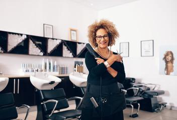 Professional female hairdresser in salon