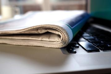 Newspaper on keyboard of laptop