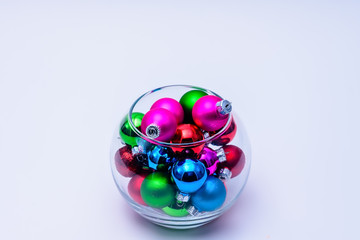 Bowl of tiny colorful ornaments