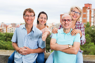 Portrait of smiling mature people in glasses outdoors together