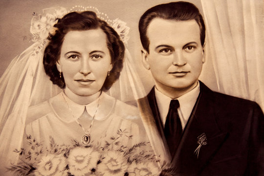 1950s original vintage photo of the young Romanian couple on a wedding day. Sepia-toned desaturated color.
