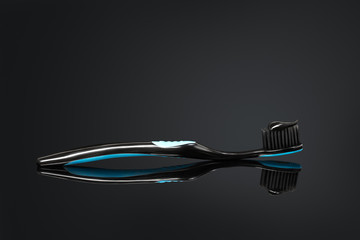 Toothbrush with black charcoal toothpaste