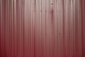 Red iron fence. Fencing of the territory.