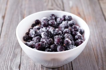 Frozen black currant in a bowl