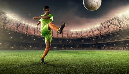 soccer player hits a ball on soccer field