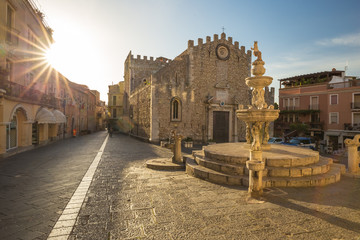 Sunrise at Fontana di Piazza Duomo and Umberto Corso street in Taormina, Sicily island, Italy