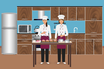 Two young women confectioners cooking desserts with pastry bag. Pastry-cook master class to make cakes.