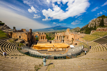 Panoramic view of beautiful town of Taormina with its greek amphitheatre and Etna volcano background, Sicily island, Italy Wall mural