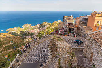 Panoramic view of small Village of Castelmola, overlooking town of Taormina with sea background, Sicily island, Italy