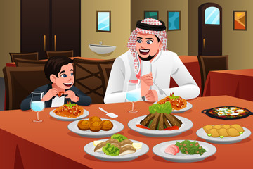 Muslim Arabian Man Eating With His Son