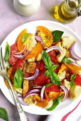 Panzanella - traditional italian tomato salad with bread and onion.Top view.