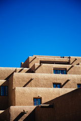 Adobe style building in Santa Fe, New Mexico against a clear blue sky