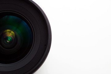 close-up view  of a camera lens on a white background