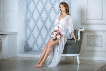 Beautiful sexy lady in elegant white robe