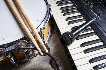 group of musical instruments including a drum and keyboard