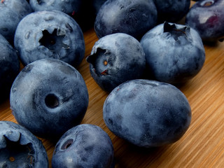 Blueberries isolated on a wooden board