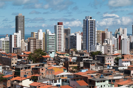 Social inequality in Salvador city: Favela and luxury buildings.