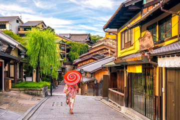 Japanese girl in Yukata with red umbrella in old town  Kyoto
