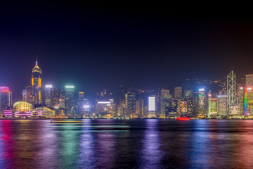 Hong Kong skyline view from kowloon side,colorful night life,cityscape and reflection on water