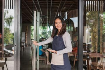waitress welcoming customer