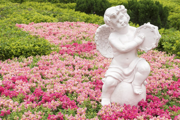 Sculpture of angel in flower garden