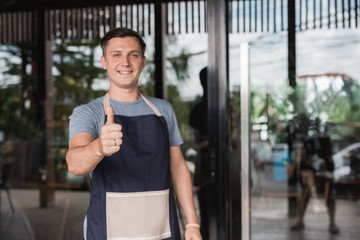 business owner showing thumb up