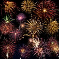 Beautiful fireworks display lights up the night time sky
