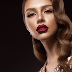 beautiful girl in Hollywood image with wave and classic makeup. Beauty face. Photo taken in the studio.