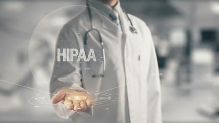Doctor holding in hand HIPAA