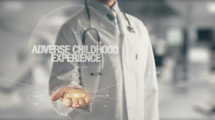Doctor holding in hand Adverse Childhood Experience