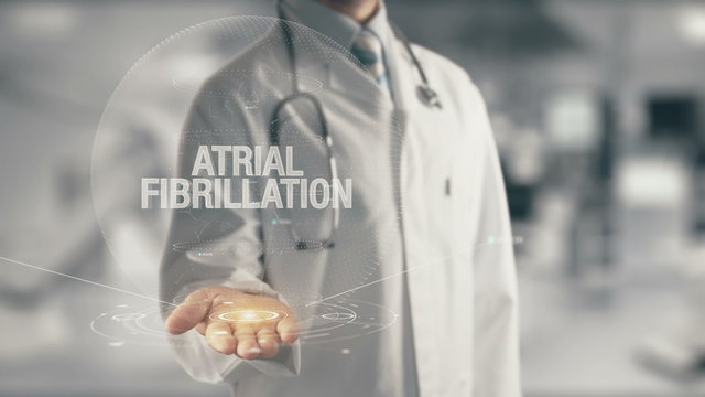 Doctor holding in hand Atrial Fibrillation