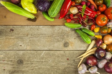Vegetables on a wooden board. Sales of vegetables on farm markets. Place for your text.