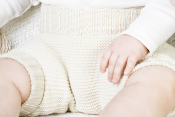 Child in a natural reusable, cotton baby diaper