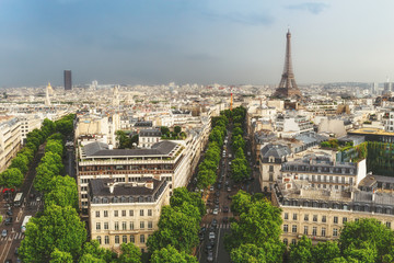 Scenic rooftop view of Paris, France, from the Triumphal Arc with the Eiffel Tower in the background. Summer travel background.