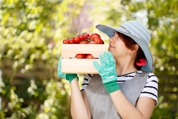 Image of woman with tomato