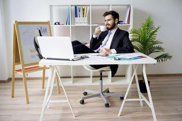 Businessman having a coffee break
