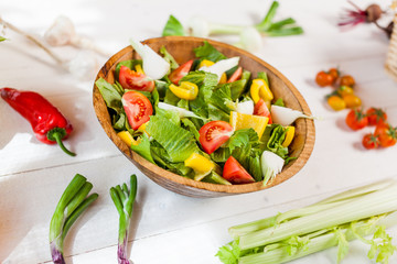 vegetable salad bowl on kitchen table, balanced diet