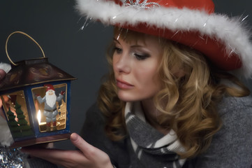 young woman with a Christmas lantern in hand