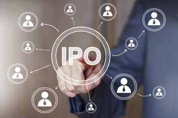Businessman presses button Initial Public Offering online network ipo