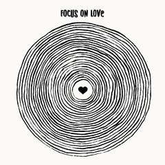 Focus on love - simple, conceptual illustration of brush circles with heart in the middle