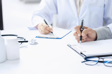 Doctor giving advice with partner about the diagnosis at a hospital