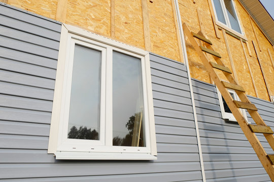 siding covering the wall of a house under construction