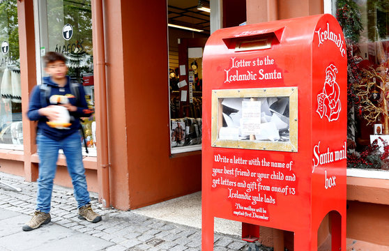 A boy looks at letter box containing letters for the Icelandic Santa in Reykjavik