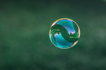 Close up of flying soap bubble