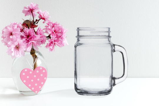 Floral mock-up of a mason jar, perfect for businesses who sell decals and stickers, just overlay your designs