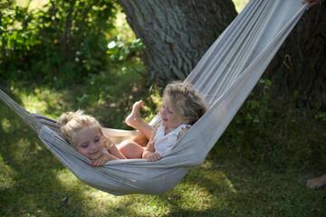 girls in hammock. fun, togetherness, garden, children.