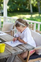 little girl drawing on paper. kid, pencil, focus, art.