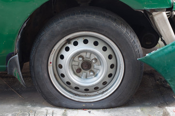 Car Flat tire and Bumper crash damage from accident waiting to claim with insurance company.